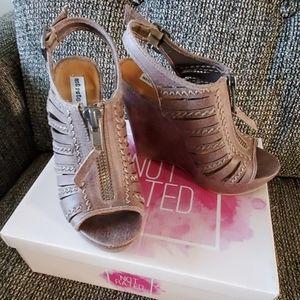 Wedge heels, never worn